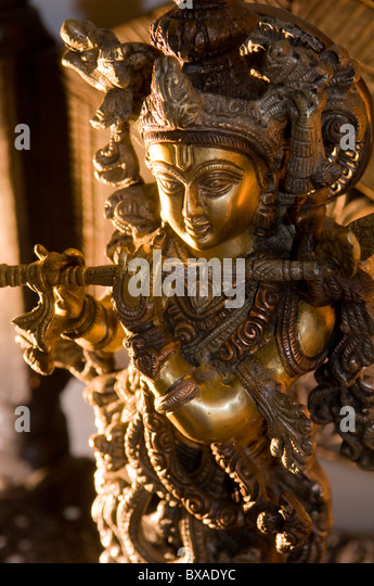 Statue of Krishna Playing a Flute - Stock Image