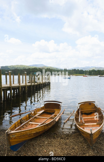 Rowing boats for hire on the shore of Lake Windermere Cumbria England - Stock Image