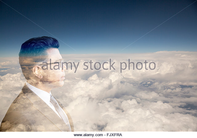Digital composite businessman with head in clouds - Stock Image