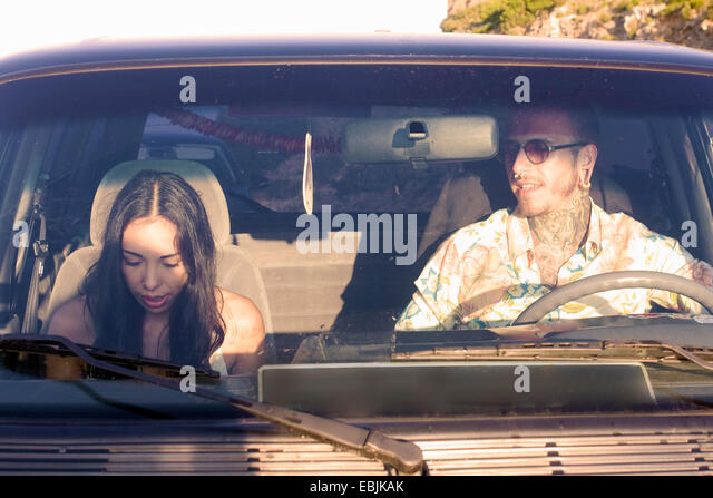 Young couple in car on road trip - Stock Image