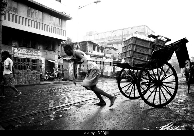 Rickshaw puller struggling, Calcutta Kolkata, West Bengal, India, 1989 - Stock Image