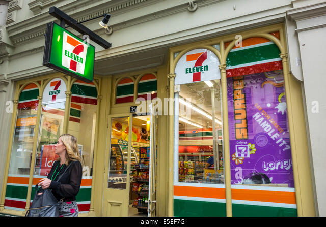 Melbourne Australia Victoria Central Business District CBD Spring Street 7 Eleven convenience store front entrance - Stock Image