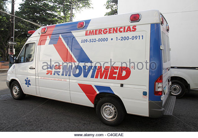 Santo Domingo Dominican Republic Ciudad Colonial Calle Isabel La Catolica traffic ambulance emergency vehicle Movimed - Stock Image