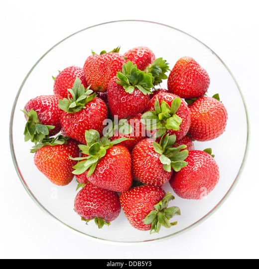 Strawberry in round plate on white background - Stock Image