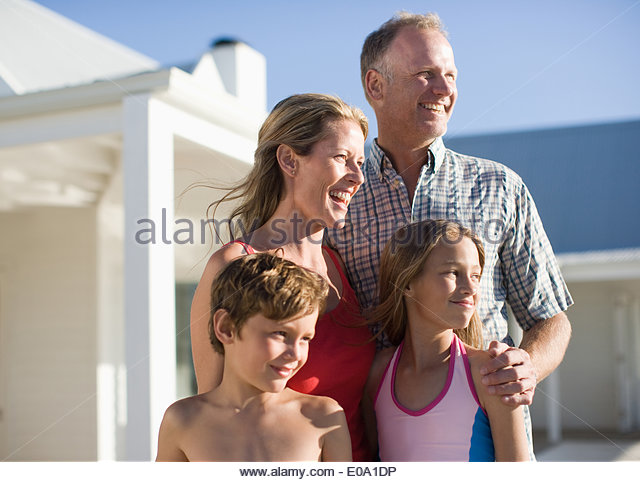 Family outdoors in swimming suits - Stock Image
