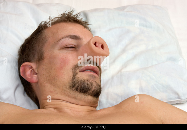 40 year old man in bed with with the Swine Flu. - Stock Image