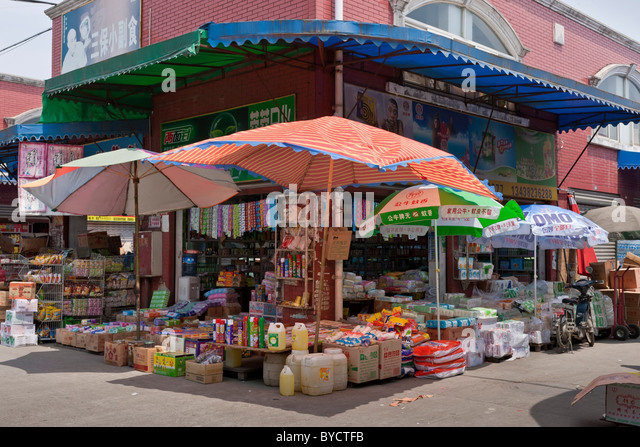 Shop in wholesale market in Chengdu, Sichuan Province, China. JMH4778 - Stock Image