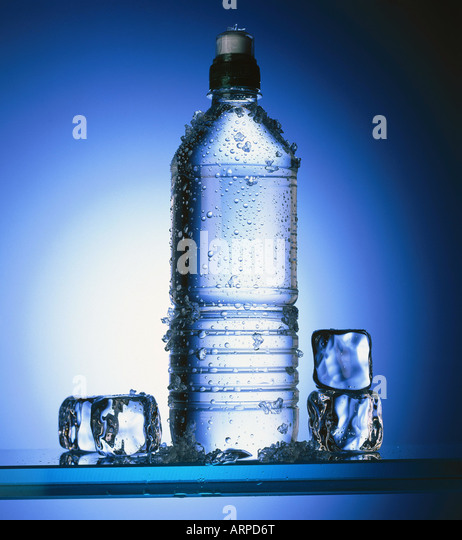 Bottle of water w ice cubes - Stock Image