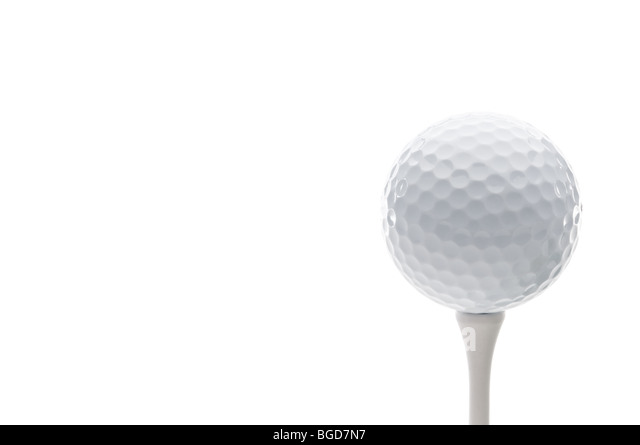 Horizontal close up of a golf ball on a tee - Stock Image
