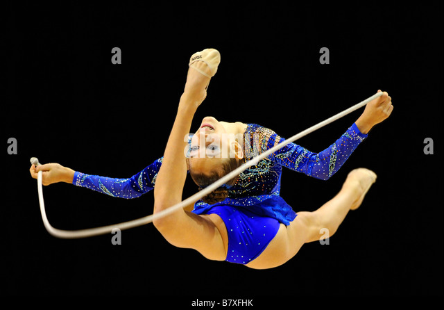 woman doing rhythmic gymnastics with rope - Stock Image