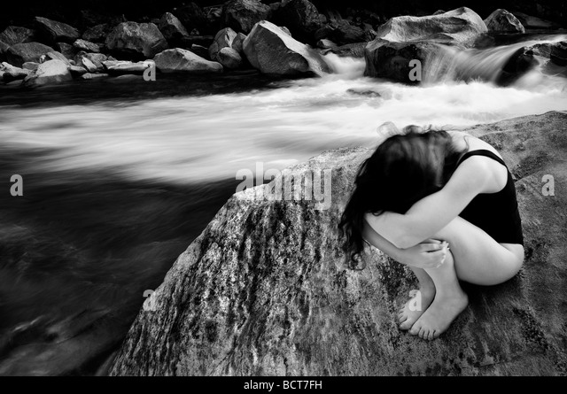 Girl near a river - Stock Image