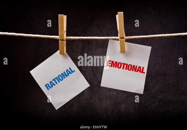 Rational vs Emotional concept. Words printed on note paper and attached to rope with clothes pins. - Stock Image