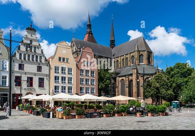 new market, street cafe, St Marys church , Marienkirche, Rostock , Mecklenburg-Vorpommern, East Germany - Stock Image