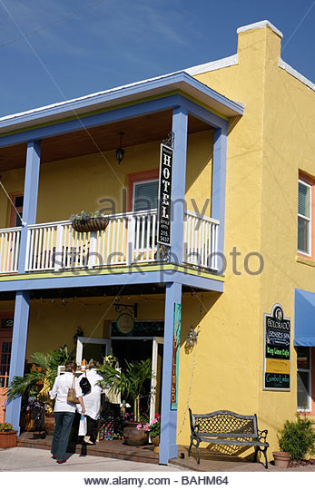 Florida Stuart Historic Downtown The Colorado building renovated shops business district man walking balcony railing - Stock Image