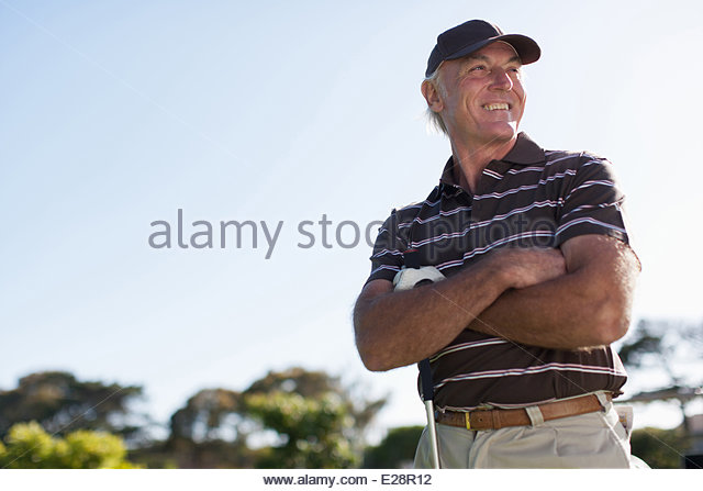 Men playing golf - Stock Image