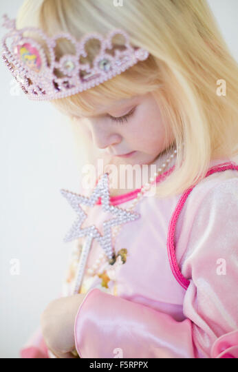 Sweden, Side view of girl (4-5) in princess costume - Stock Image