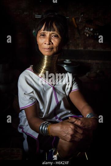 Lake Inle, Myanmar, 17th November, 2014: Kayan tribe woman in her kitchen posing - Stock-Bilder