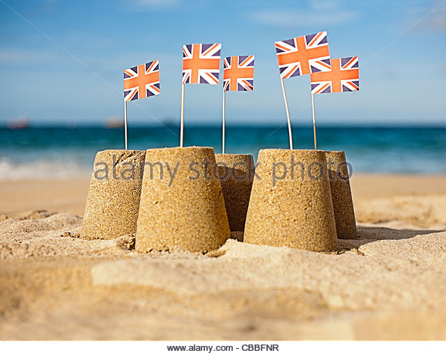Sandcastles with Union Jack flags - Stock-Bilder