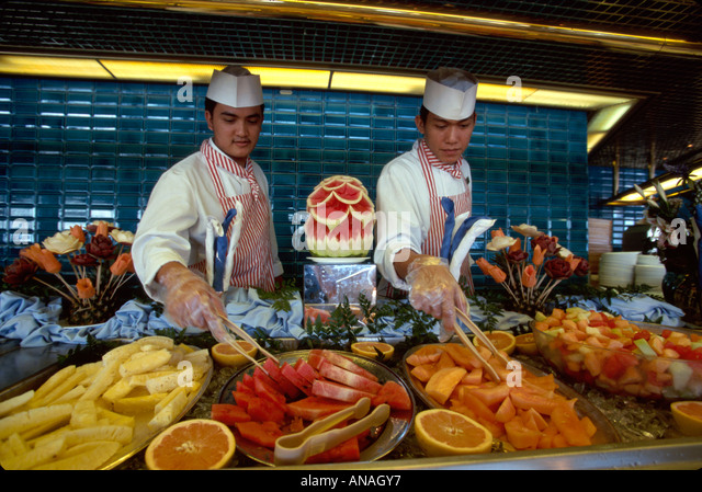 Bahamas Atlantic Ocean Holland America Line ms Maasdam cruise ship Asian food service workers cafeteria buffet line - Stock Image