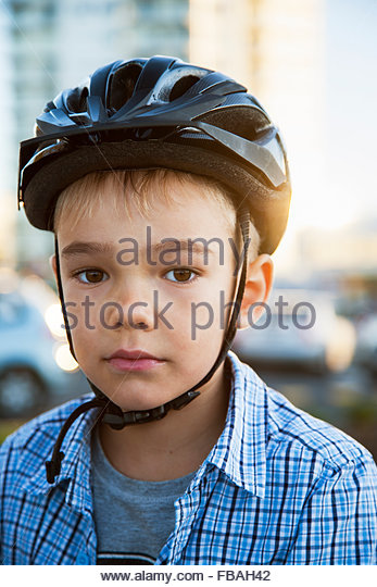 Australia, Portrait of young boy (6-7) in cycling helmet - Stock Image