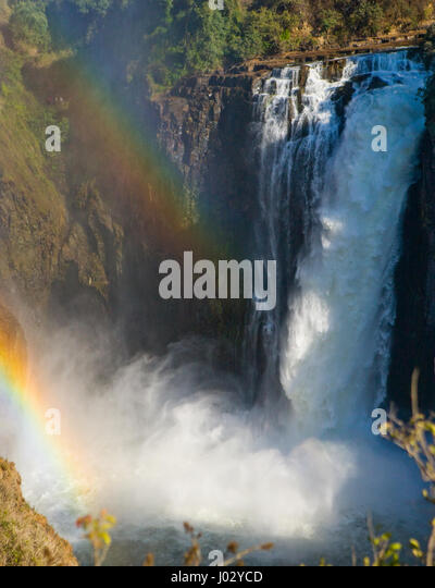 Victoria Falls. A general view with a rainbow. National park. Mosi-oa-Tunya National park. and World Heritage Site. - Stock Image
