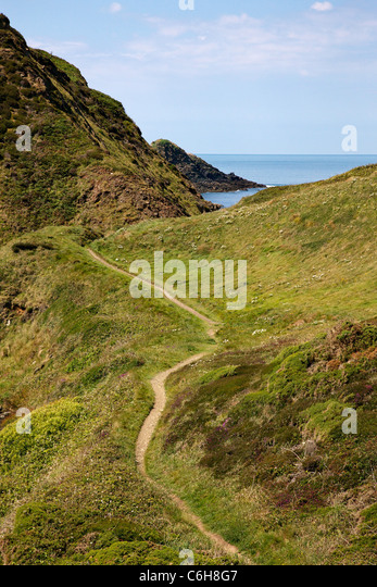 Section of the south west coast path on the Devon Cornwall border near Hartland Quay looking towards Gull Rock - Stock Image