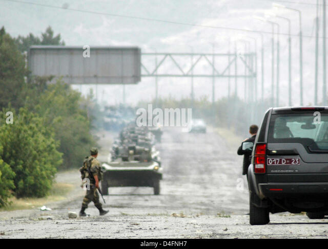 (FILE) - Armoured Russian mechanized infantry combat vehicles drive in convoy out of Gori, Georgia, Thursday, 14 - Stock Image