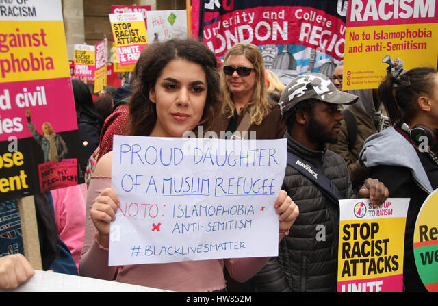 London, UK. March 18, 2017: A Muslim youth holds up her placard during a demonstration on the UN Anti-Racism Day - Stock Image