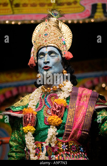 Indian actor dressed as Krishna performs street theatre mahabharata play - Stock Image