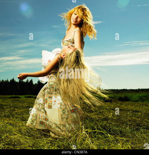 Mother and daughter having fun on field. Summer day - Stock-Bilder