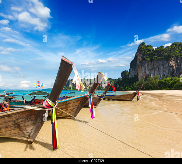 Long tail boats on tropical beach in Thailand - Stock Image