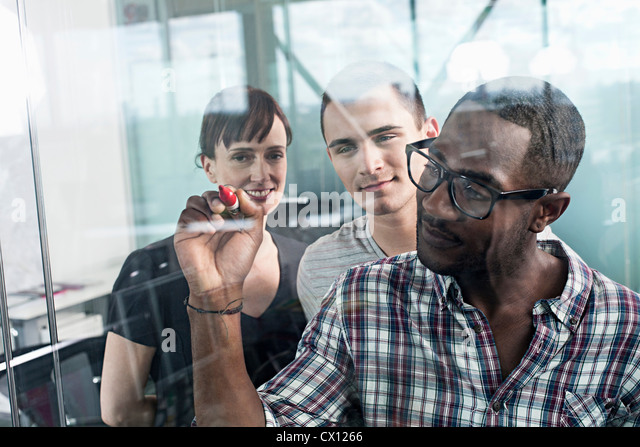 Man writing on glass - Stock Image