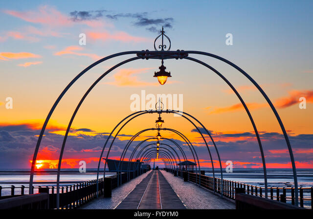 Southport Pier, Merseyside, UK. 26th April, 2016. UK Weather. Sunset over the Irish Sea as seen from Southport seafront - Stock Image