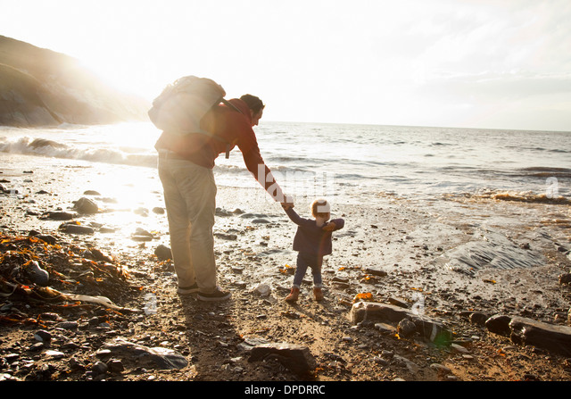 Father and child enjoying beach - Stock-Bilder