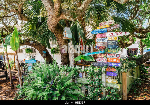 Colorful and funny directional signs in front of a small beach home, - Stock Image