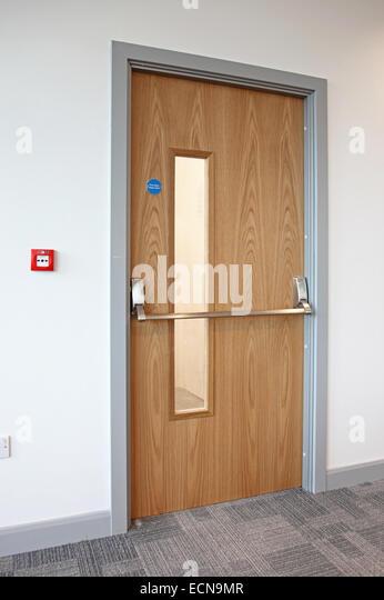 modern office door. Oak Finished Fire Escape Door In A Modern Office. Shows Panic Bar, Office