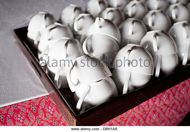 Close up of stacked tea cups - Stock Image
