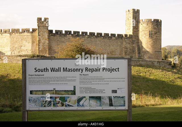 England UK Alnwick Castle 11th century Norman architecture sign repair project privately funded - Stock Image