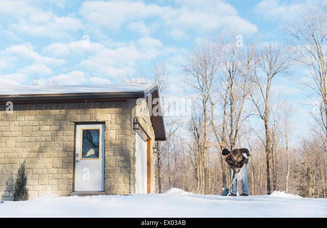 Man shoveling snow, Young's Point, Ontario, Canada - Stock-Bilder