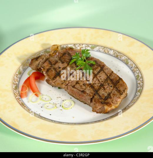 Pork steak on plate, close-up - Stock-Bilder