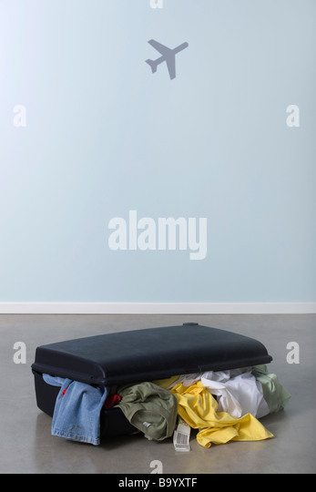 Overstuffed suitcase - Stock Image