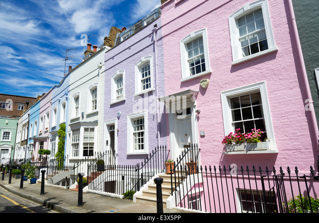 Colourful row of terraced town houses on Bywater Street, Chelsea, London, England, UK - Stock Image