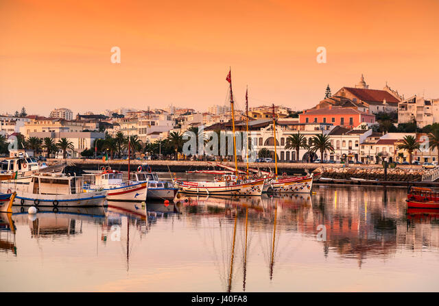 Old fishing boats in the harbor of Lagos, Algarve, Portugal - Stock Image