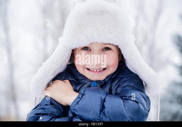 Portrait of boy (6-7) in fur hat - Stock Image
