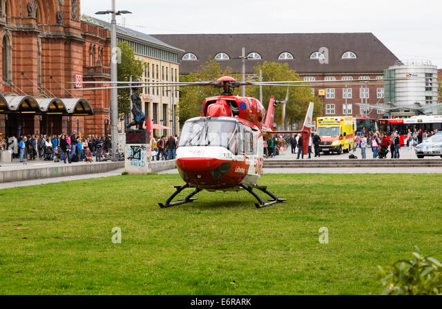 Emergency helicopter landed on the grass outside Bremen Hauptbahnhof. - Stock Image