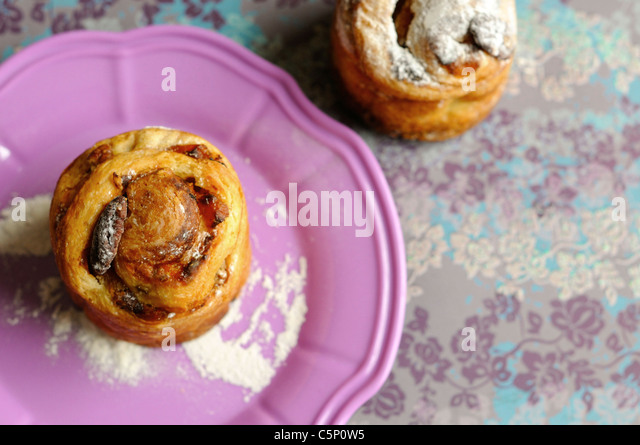 Pecan and  apricots buns on a pinky plate - Stock-Bilder