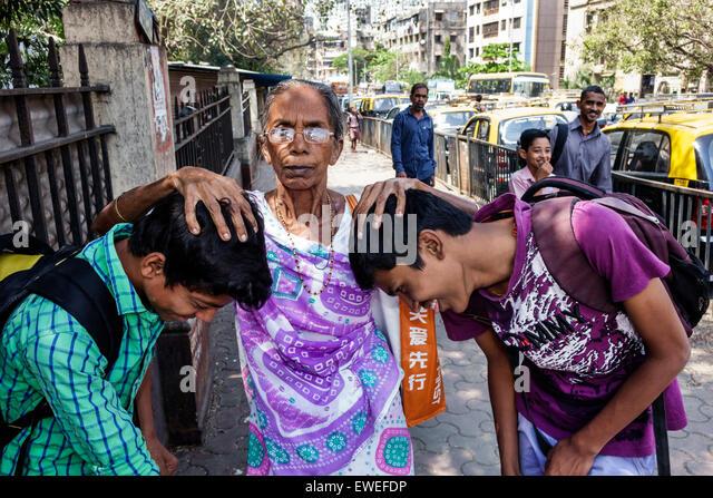 Mumbai India Indian Asian Tardeo Jehangir Boman Behram Road teen boy friends student senior woman grandmother showing - Stock Image