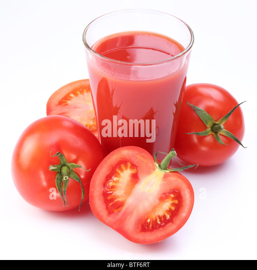 Fresh tomato juice and ripe tomatoes round glass. - Stock-Bilder