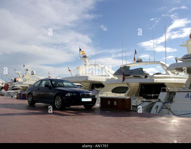 BMW car and boats Puerto Banus Costa del Sol Spain - Stock Image