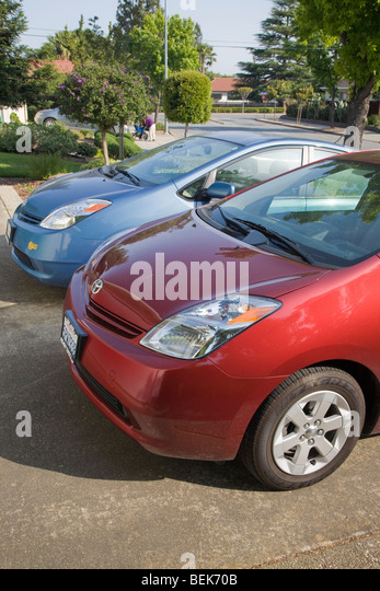 A close up of two parked Toyota Prius hybrid cars. Cupertino, California, USA - Stock Image